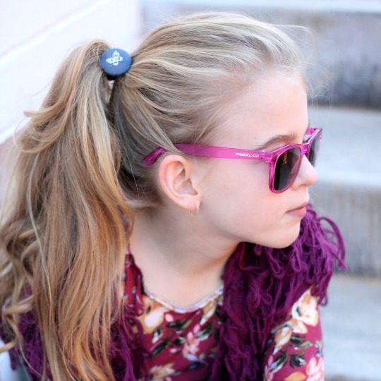 Emily wearing denim butterfly elastic