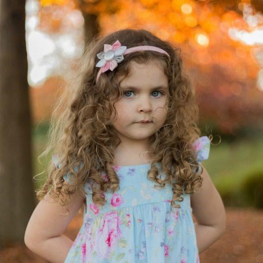 Peyton autumn pic wearing Sugar & Spice Flower Headband